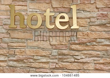 Hotel Sign On Artificial Stone Wall