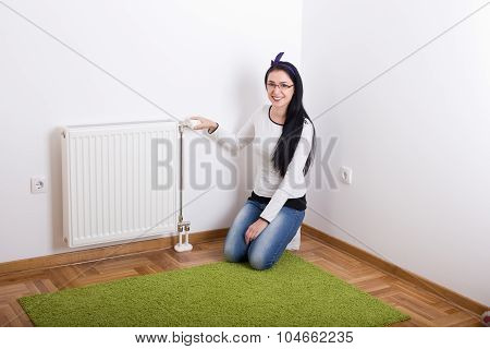 Woman Adjusting Heating