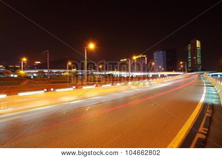 Empty Road Surface With City Buildings Of Night Scene