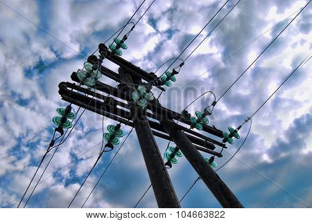 High Voltage Lines. Electricity Tower On The Clouds Background.
