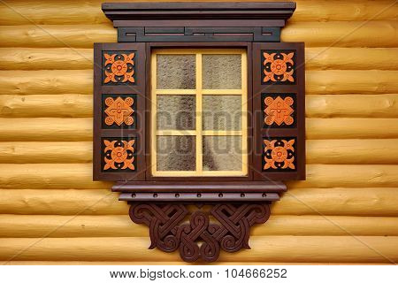 Yellow Log Cabin Wall With One Ornamental Window