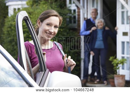 Adult Daughter Visiting Senior Parents At Home