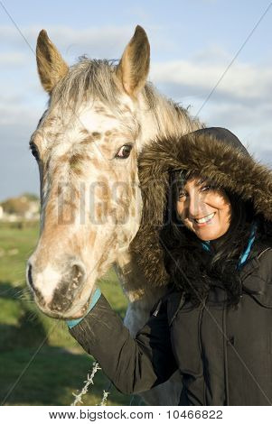 Beautiful asian woman with appaloosa horse
