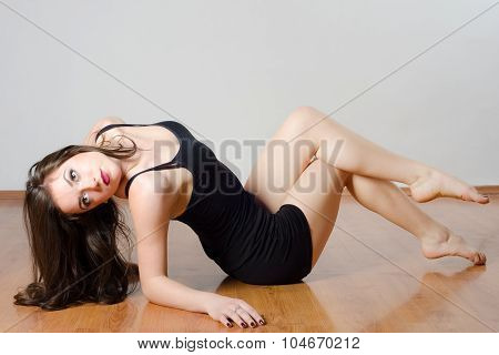 Beautiful Young Ballerina Stretching, Exercising And Dancing During Training