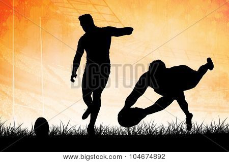 Silhouette of rugby player against rugby arena