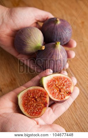 Woman Holding Figs In Her Hands.