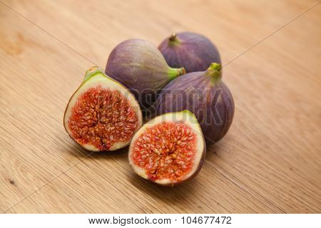 Figs On Kitchen Countertop. On Fig Is Cut In Half