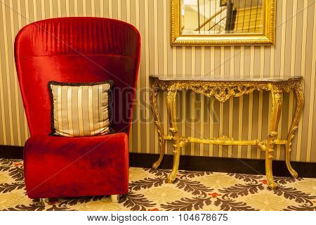 Royal Armchair In Red In Warm Athmosphere Decoration