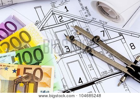 a blueprint of an architect with euro money. symbolic photo for financing and planning of a new house.