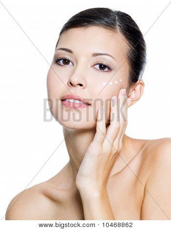 Adult  Woman Applying Cosmetic  Cream Around The Eye