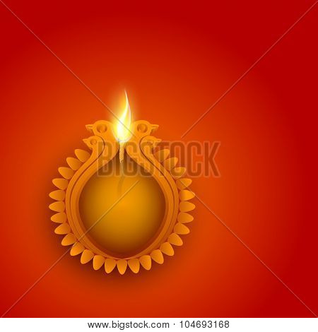 Indian Festival of Lights, Happy Diwali celebration with creative illuminated lit lamp and space for your message on shiny background.