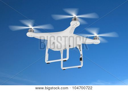 Drone, quadrocopter, in the blue sky.