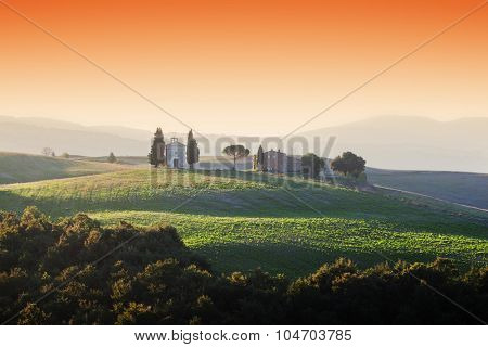 Tuscany landscape at sunrise with a little chapel of Madonna di Vitaleta, San Quirico d'Orcia, Italy