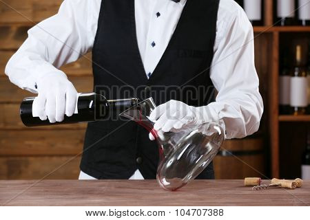 Bartender working at counter on bar background