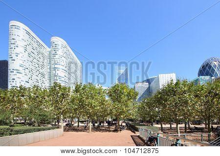 PARIS, FRANCE - SEP 12, 2014: Green area near Coeur Defense skyscraper in La Defense business district in Paris