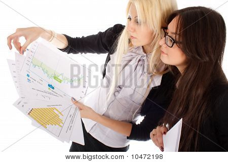 Two Businesswoman Looks On The Graph