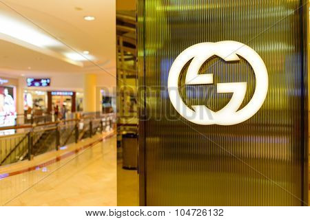 KUALA LUMPUR, MALAYSIA - APRIL 23, 2014: Gicci logo on the wall. Gucci is an Italian fashion and leather goods brand, part of the Gucci Group