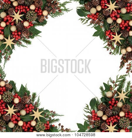 Christmas background border with star and gold bauble decorations, holly, mistletoe, ivy and winter greenery over white.