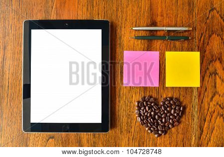 Digital Tablet Pc, Pen, Colorful Stick Note And Coffee Bean With Heart Shape On Wood Background