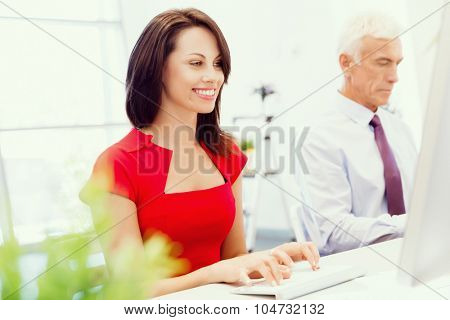Two business collegues working together in office