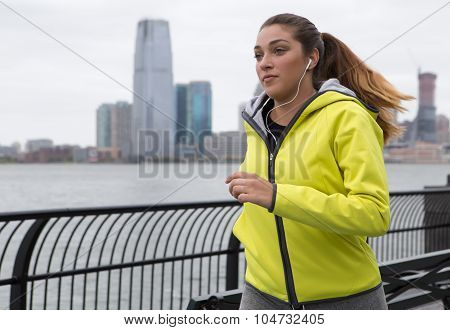 Young Woman Jogging By The River