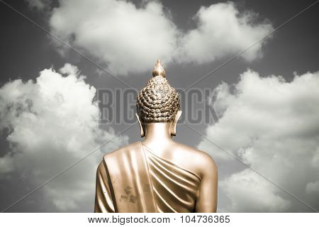 Golden Buddha Statue From Back Focused On Head  Golden Split-tone Black And White