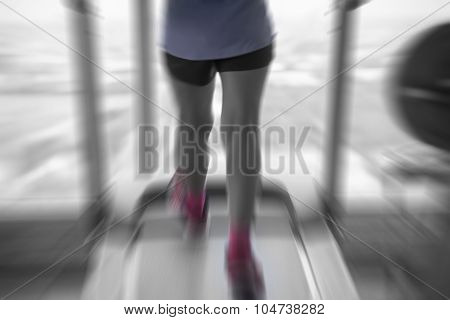 Unknown Woman Running In Gym From Back Side In Pink Shoes With Motion Radial Blur Split-tone