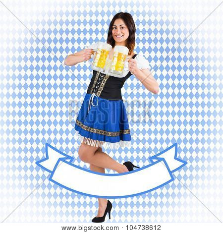 Pretty oktoberfest girl holding beer tankards against blue pattern