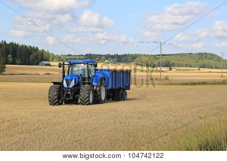 New Holland Tractor And Blue Trailer Autumn Field Landscape