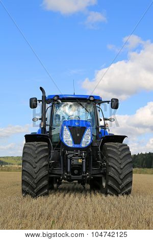 New Holland T7.250 Tractor On Stubble Field, Vertical View
