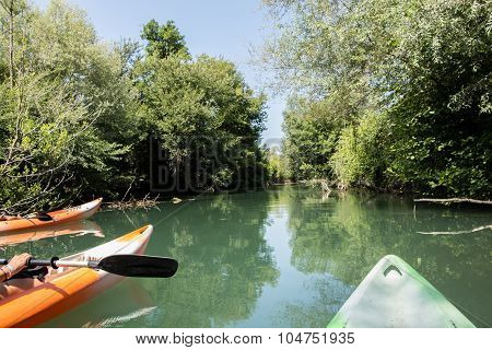 River View From The Kayak, With Group Of Kayak Boats Front Parts On The Picture