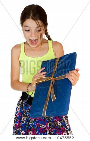 Primary Age Girl Excited To Receive A Gift