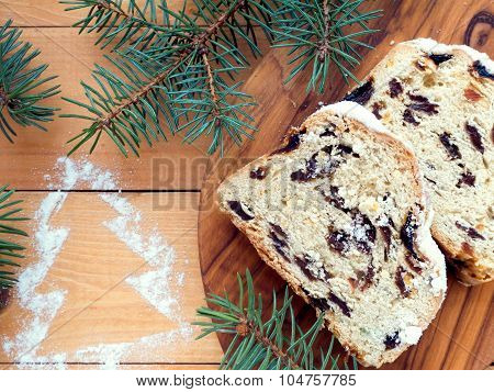 Stollen Cake On The Textured Wooden Board And Sugar Christmas Tree Drawing