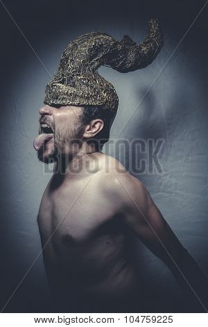 naked man with helmet warrior trumpets, and pain nightmare