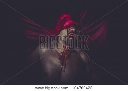 Paranormal, naked man on large red cloth over his eyes