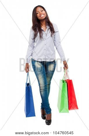 Beautiful black woman smiling and holding shopping bags