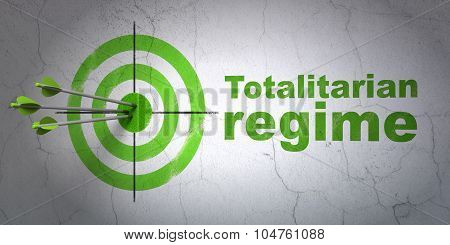 Political concept: target and Totalitarian Regime on wall background