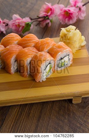 Salmon Sushi Roll On A Gete Over Wooden Vintage Background