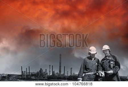 red sunset over chemical industry and refinery workers
