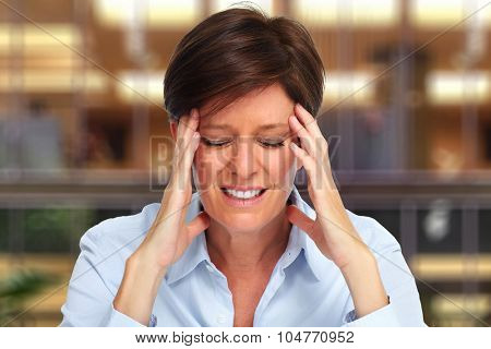 Tired business woman with headache migraine over house background