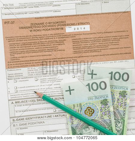 Polish tax form with pencil and cash
