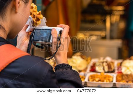 Back Side Of Young Woman Taking A Photo Of Belgian Waffles