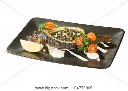 Stuffed seabass on a black plate