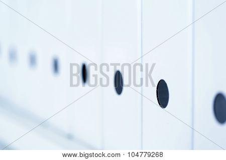 Row Of White Folders Standing On Bookshelf
