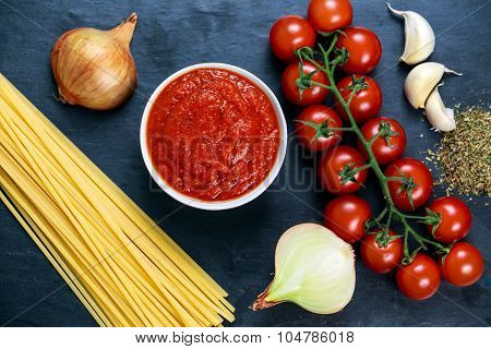 Ingredients For Spaghetti With Marinara Sauce.  Ready To Cook. On Blue Background