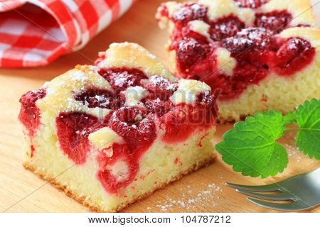 raspberry sponge cake slices on cutting board