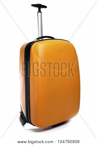 Orange suitcase for travel close up on a white background