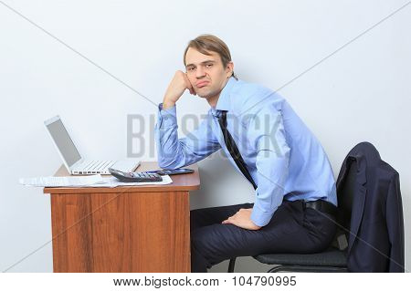 disgruntled manager at his desk.