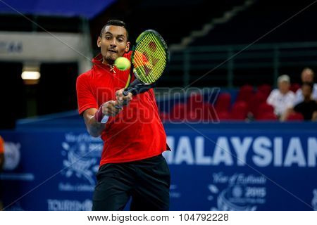 KUALA LUMPUR, MALAYSIA - OCTOBER 02, 2015: Australia's Nick Kyrgios plays a backhand return in his match at the Malaysian Open 2015 tennis tournament held at the Putra Stadium, Malaysia.