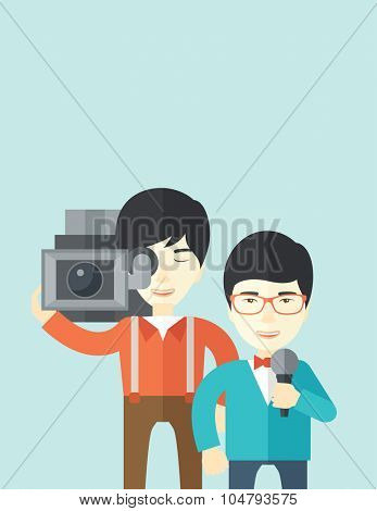 An Asian cameraman filming a reporter vector flat design illustration isolated on blue background. Vertical layout with a text space.